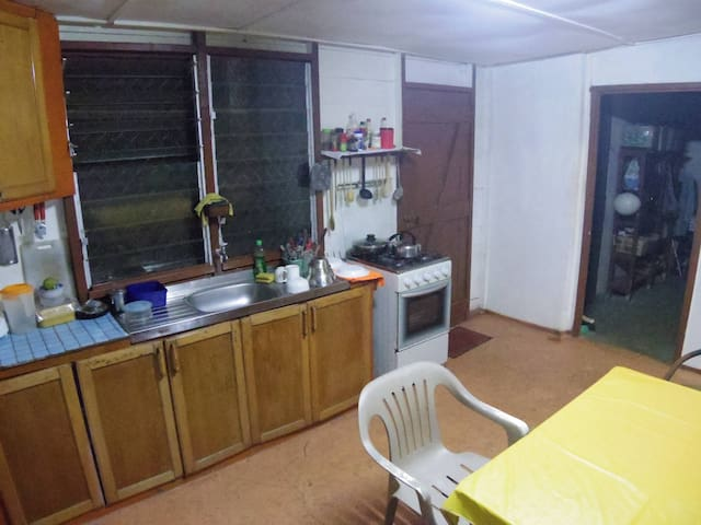 kitchen with gas stove/oven/dining table