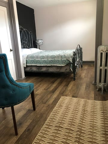 Queen Size Bed on East Side of second floor home.