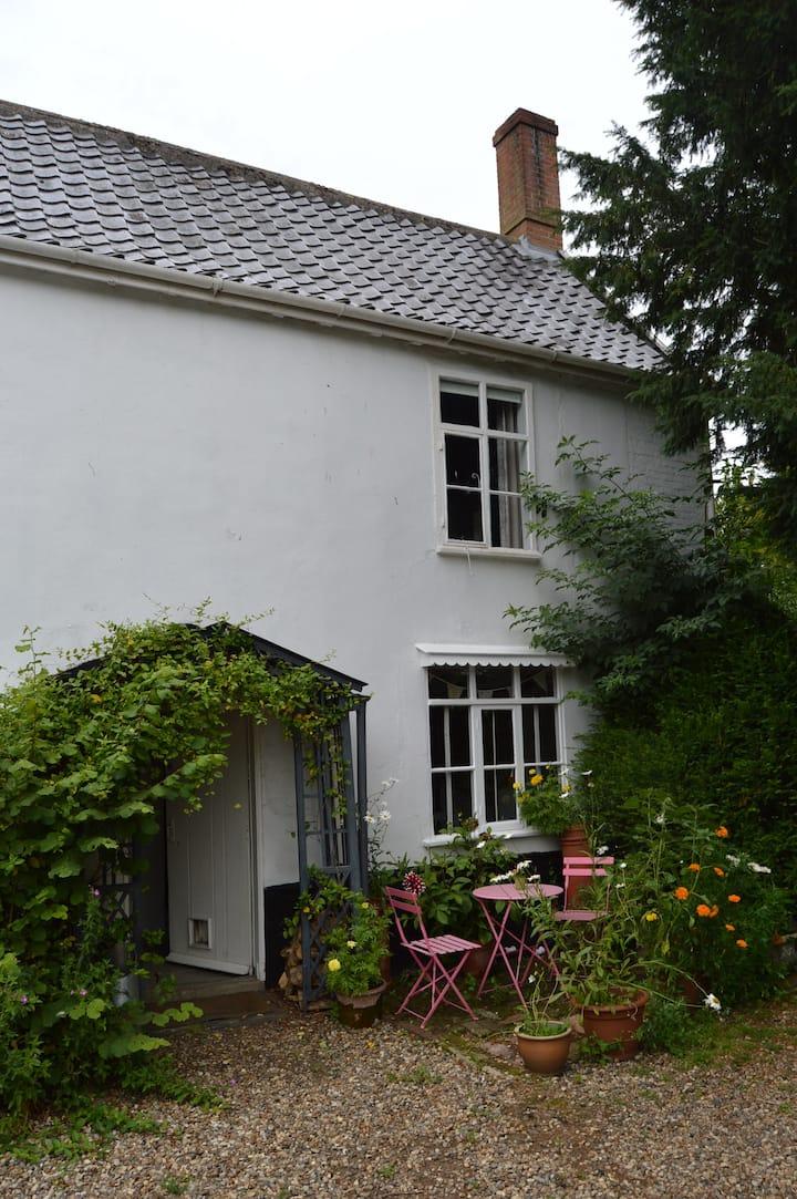 Eclectic bijou cottage & gardens
