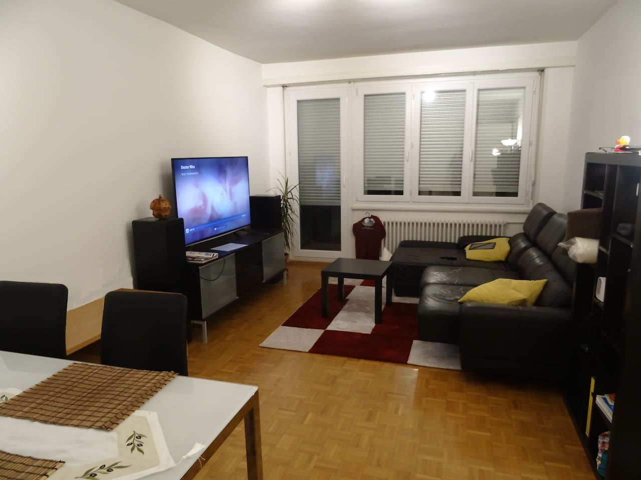 Living room with dining table, sofa and TV