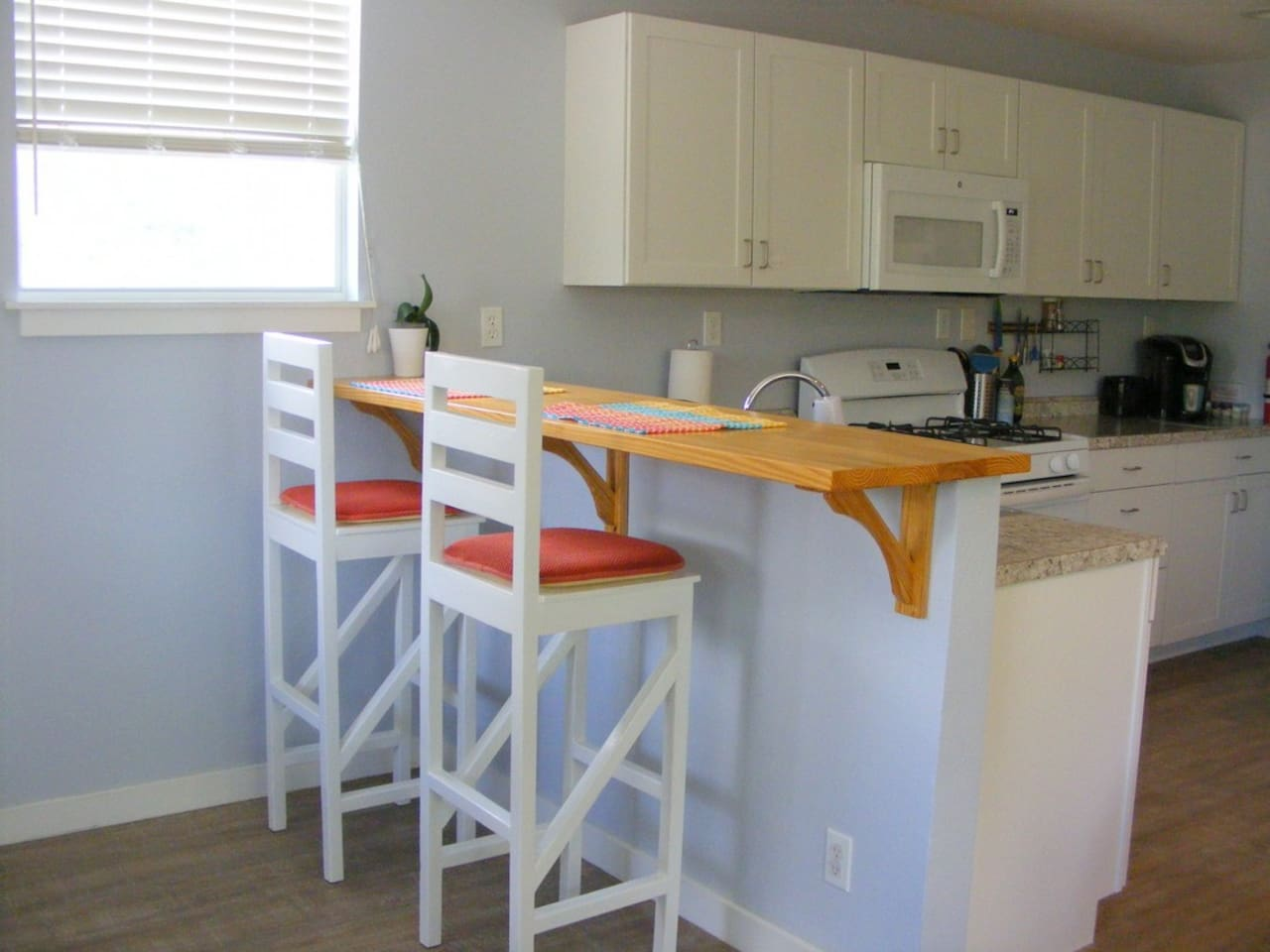 Bar stools and counter as you come in the front door.