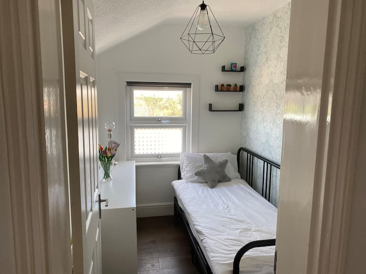 Light and airy single room near the train station