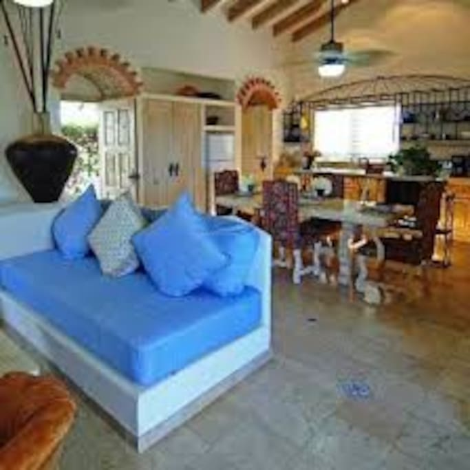 Large living room with sleeper and tv , ocean view deck