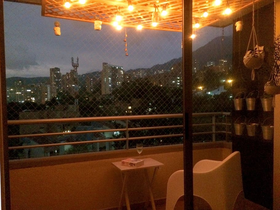 Romantic balcony with dimmer lights! Just bring some wine...