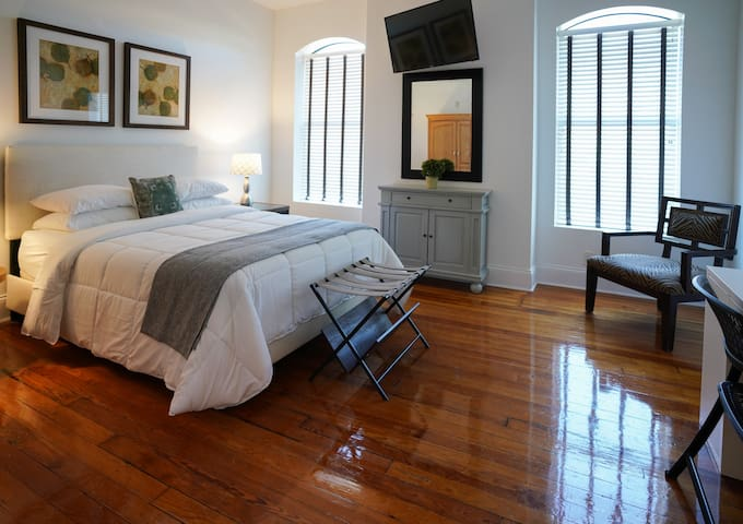 Large windows allow for plenty of natural light and cool breeze. This room is room 206, on our main floor.