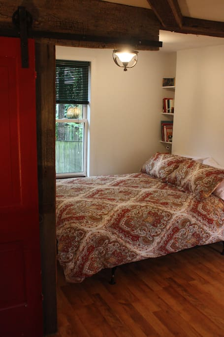 Comfortable queen size bed with surrounding barn board from Opa's barn