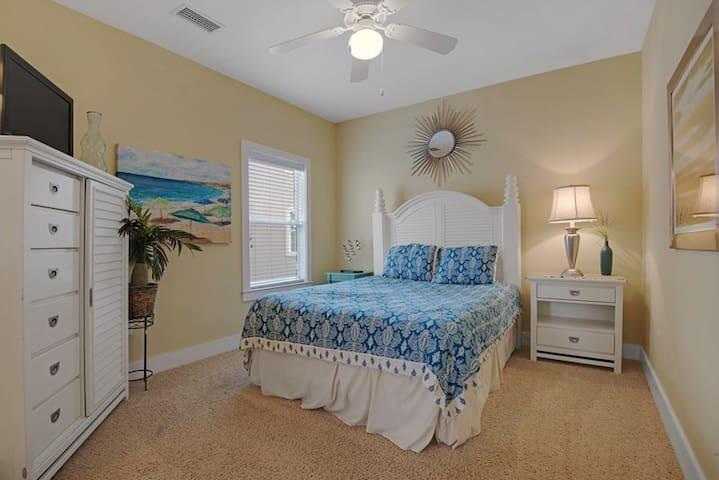 Guest bedroom upstairs with queen bed.
