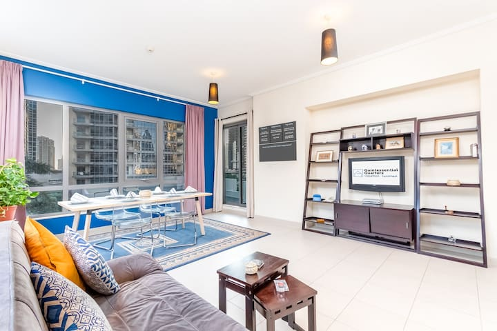 Living and dining room with access to balcony