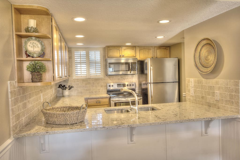 Brand new stainless steel appliances give the kitchen a high end urban feel