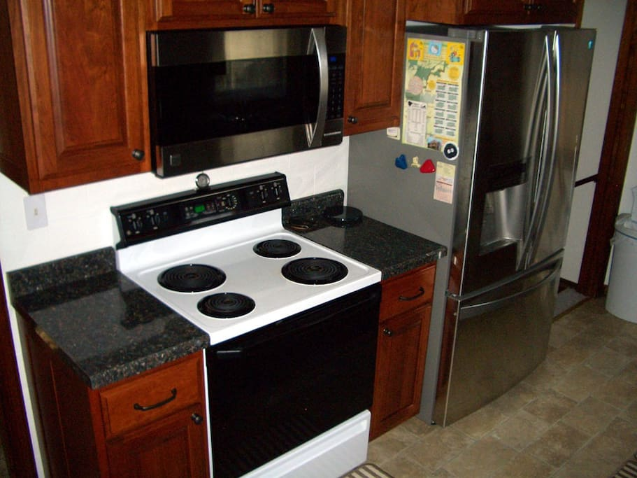 Kitchen - Stove, microwave, and full size fridge