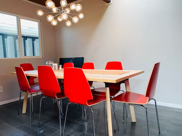 Dining table with 8 chairs (plus 2 extra) great as work area as well.