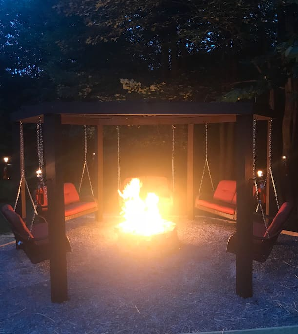 The swingset fire pit is the ultimate vacation hangout spot! The tiki torches are treated with bug repellant.