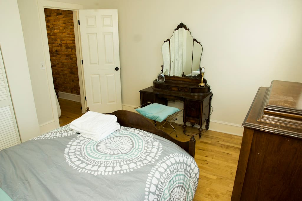 The room is fitted with antique hardwood furniture.