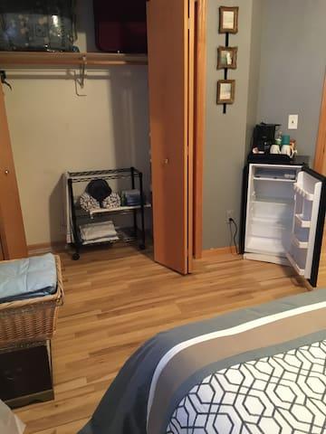 Guest room - mini fridge - closet space -coffee pot