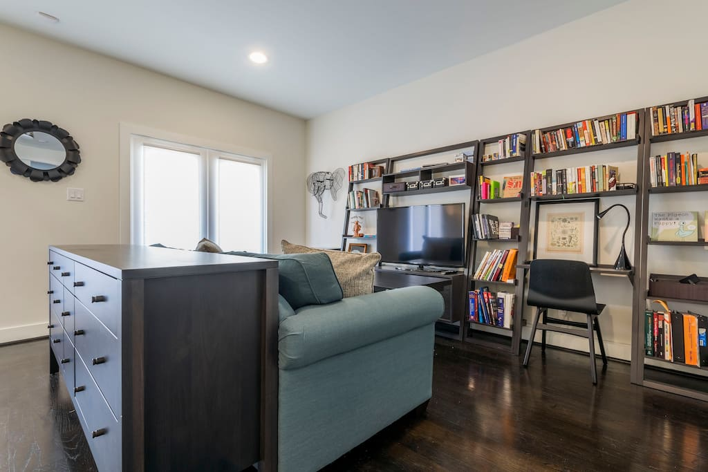The first floor bedroom has a HD TV, a work-space, and lots of books to borrow.