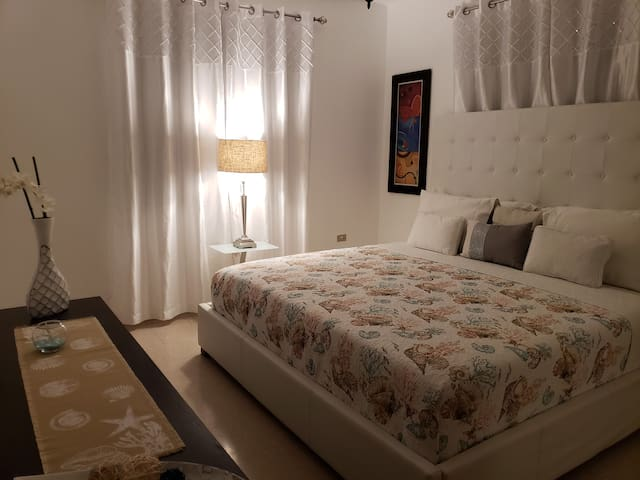 Master bedroom with king size bed and memory foam mattress, air conditioning and Smart TV.