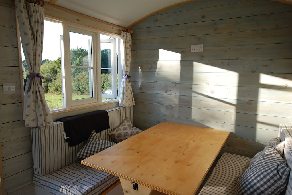 Inside family hut -  table and seating to king size bed
