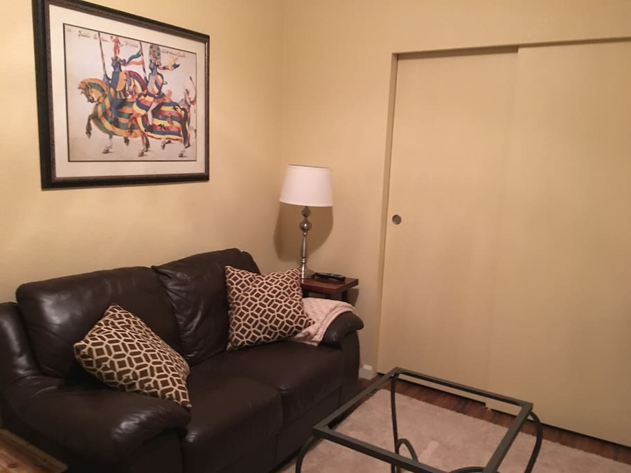 Comfortable private sitting room across hallway from bedroom. Great workspace or perhaps some wine and cheese? TV with cable also provided.