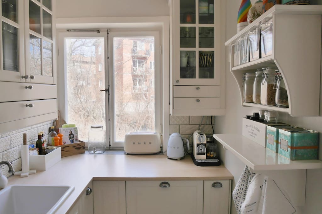 Cute kitchen, complete with espresso machine and dishwasher, offers all you need during your stay.