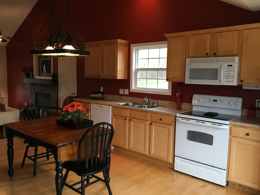 Fully equipped kitchen with dishwasher, electric range and refrigerator.