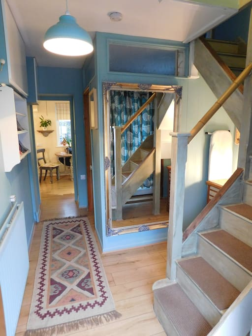 Entrance hall with staircase leading to the bedroom area.