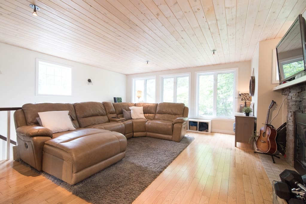 Plenty of space for everyone on the big, comfy sectional couch in the living room