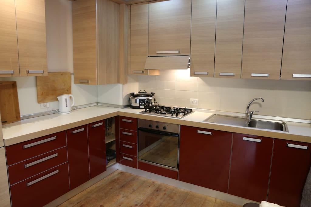 Well equipped kitchen area including dishwasher, microwave and slow cooker