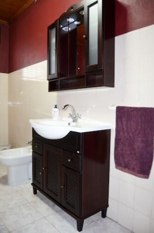 Full bathroom with tub with shower head, bidet, toilet and sink. Towels are supplied along with toilet paper, shampoo, conditioner and body loiton.