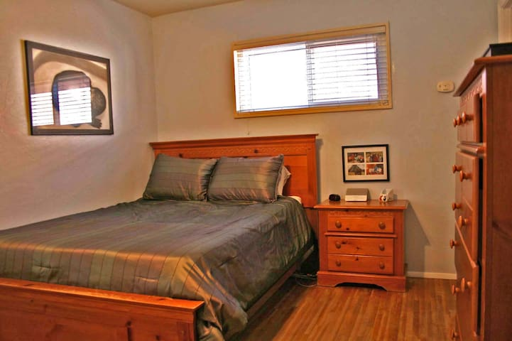 Master bedroom with queen-sized bed and bathroom attached.
