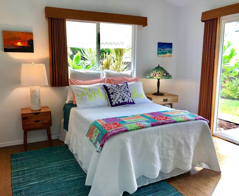 Bright and cheery guest bedroom with comfy bed and private entrance, ceiling fan and plenty of fresh air and lighting.