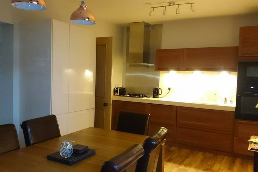Modern, well equipped kitchen with dining area
