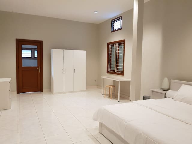 Spacious Bedroom with working table for business travellers