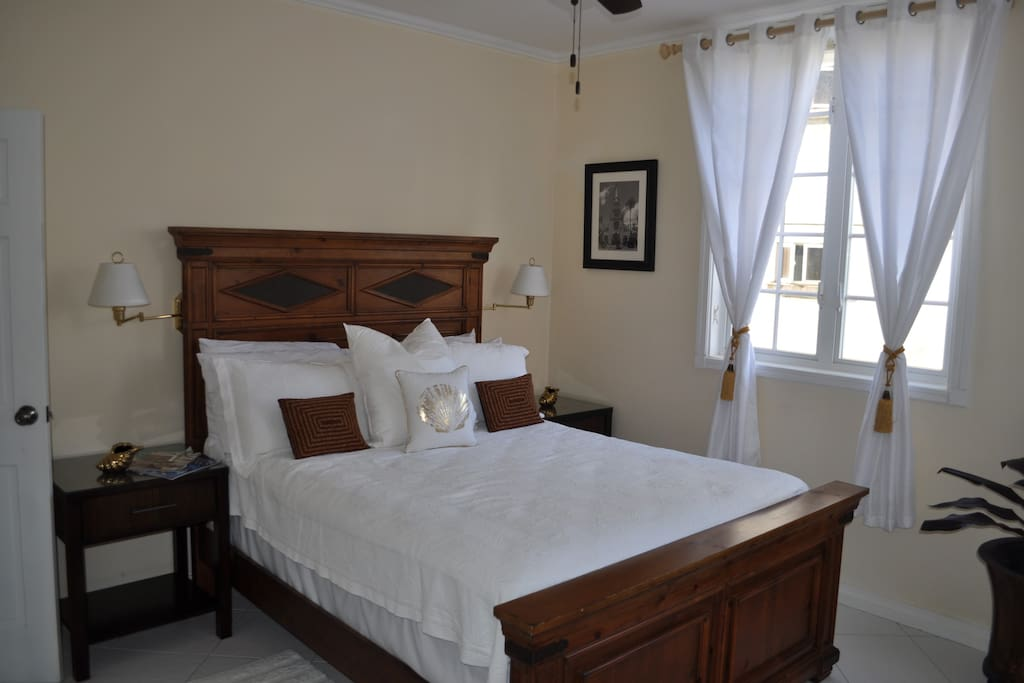 Private Room & Bathroom, features queen sized bed, ceiling fan, large windows that let in plenty sunlight.