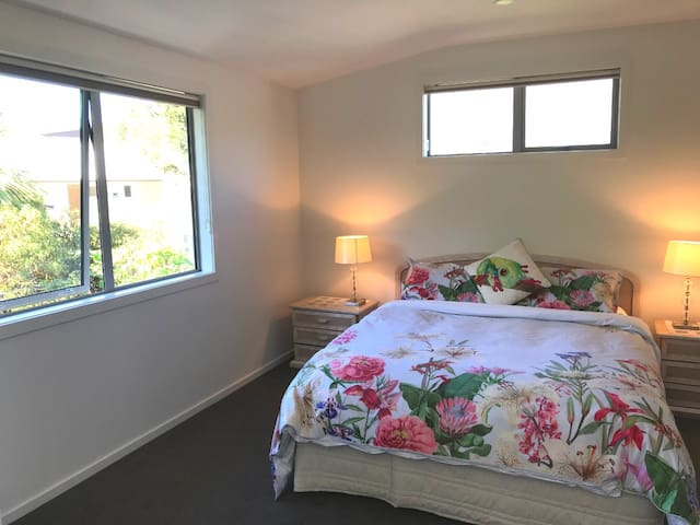 Light and airy Queen bedroom with electric blanket and spare bedding