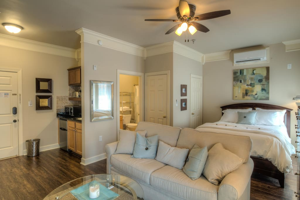 Lots of warm touches here, like crown molding and hardwood floors.