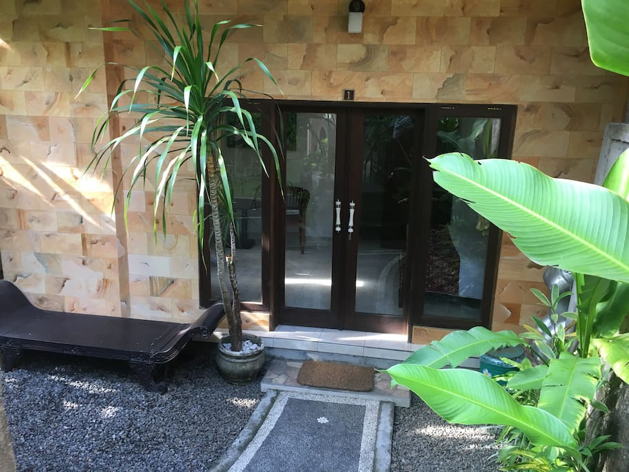 Your private entrance. Glass doors with curtains allow lots of light or privacy. View is to the garden.