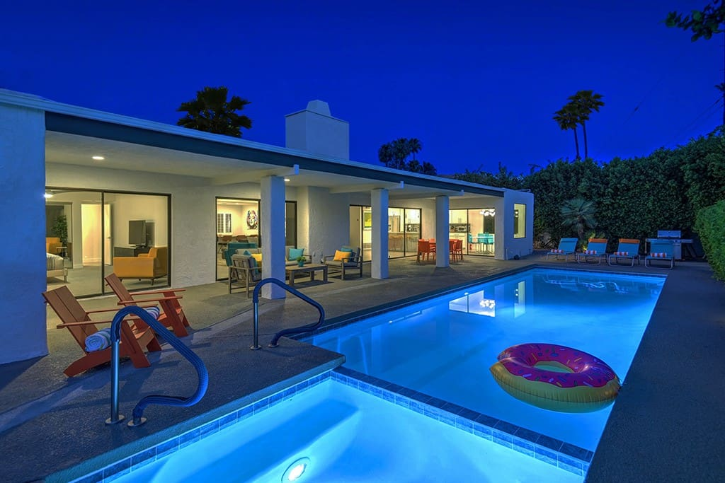NIGHT BACK OF HOUSE REVERSE - TWIN PALMS TRANQUILITY - PALM SPRINGS VACATION RENTAL POOL HOME