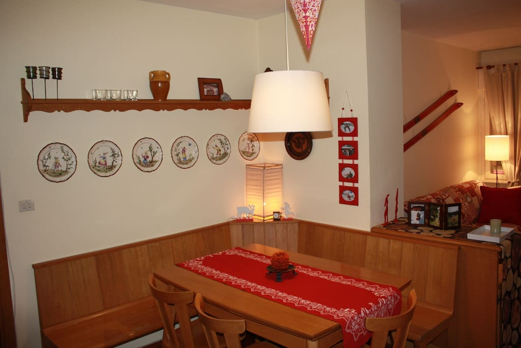 Dining room with wide wooden bench and table (seats up to 10 people)