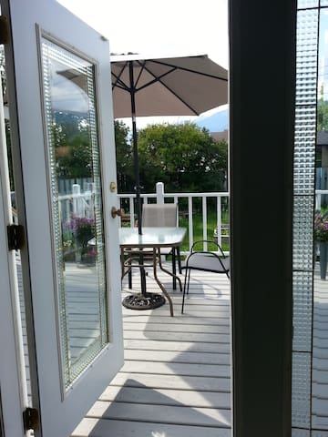 Spacious deck overlooking garden, great for coffee while breakfast is served.
