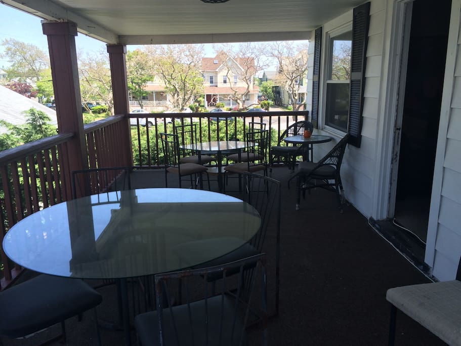 Huge porch with 3+ tables and lots of chairs