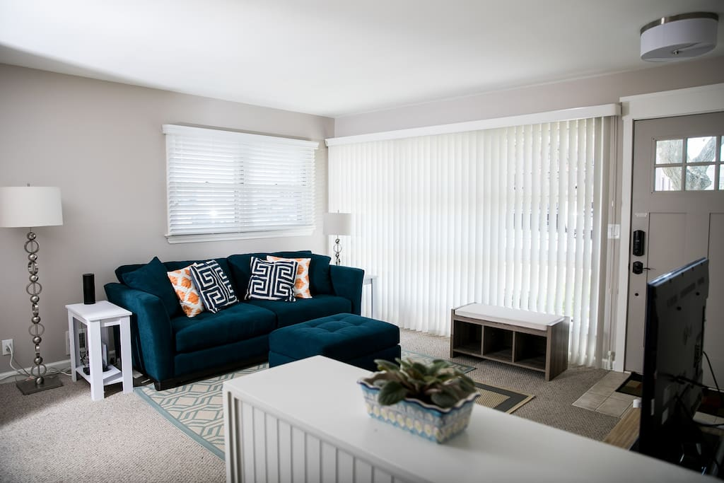 Front Living Room includes fold-out, Queen sofabed.  Wait until you see the back Family Room!