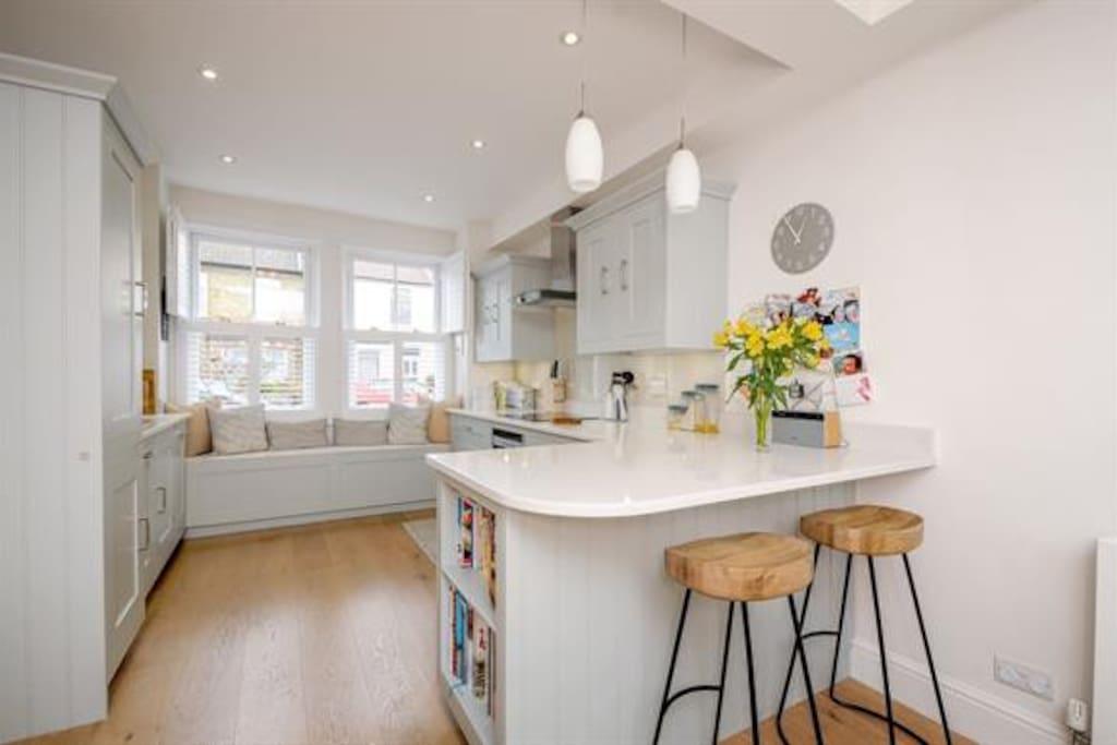 Modern, high spec kitchen with small breakfast bar