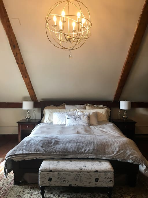 In the sleeping loft, there is a king bed with dimmable chandelier and reading lamps. The perfect place to get a great night sleep. The floors are very rustic and uneven because they have shifted in the last 250 years, the bed is even though!