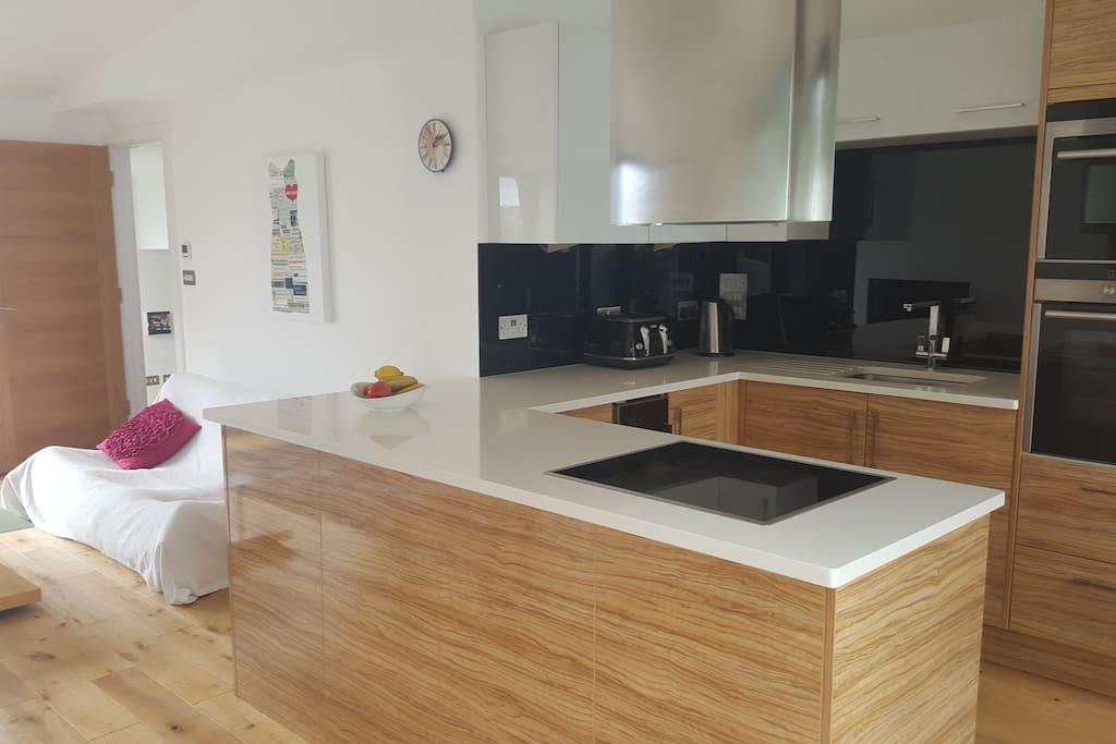 Kitchen with wine cooler fridge, double oven, plenty of equipment.