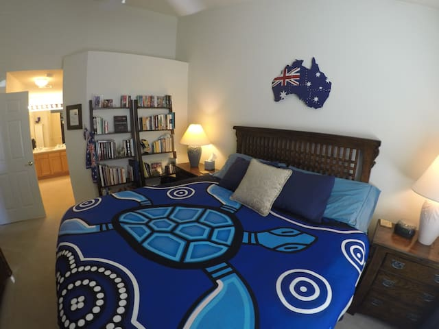 """A view of our """"Australia Room"""" Master Suite.  Equipped with a luxurious plush-firm-King Sized bed, Flat Screen TV & Blu-Ray/DVD player.  Plenty of hanging space in Armoire - Luggage rack provided."""