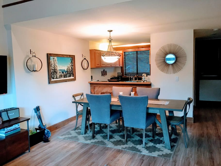 Large dining table that easily seats 8, but can get up to 12 around table for dinner and games. Bar stools offer additional seating at the kitchen counter.