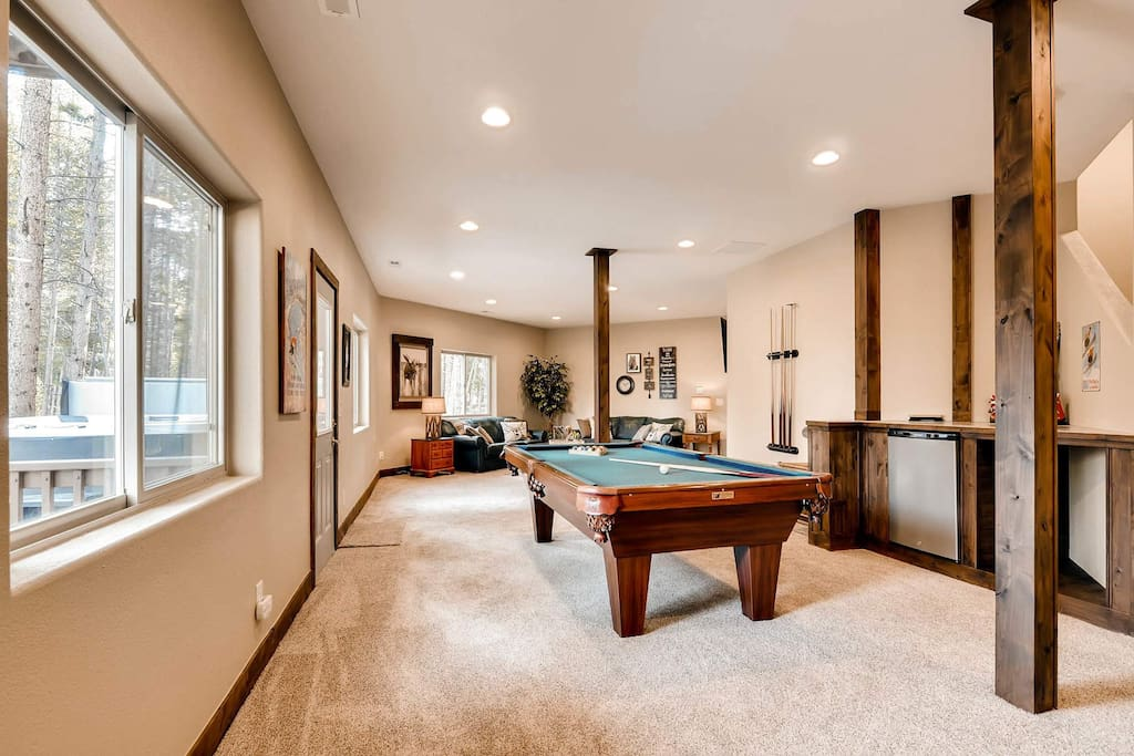 The downstairs family room allows access to the hot tub as well as a pool table for some friendly family fun.