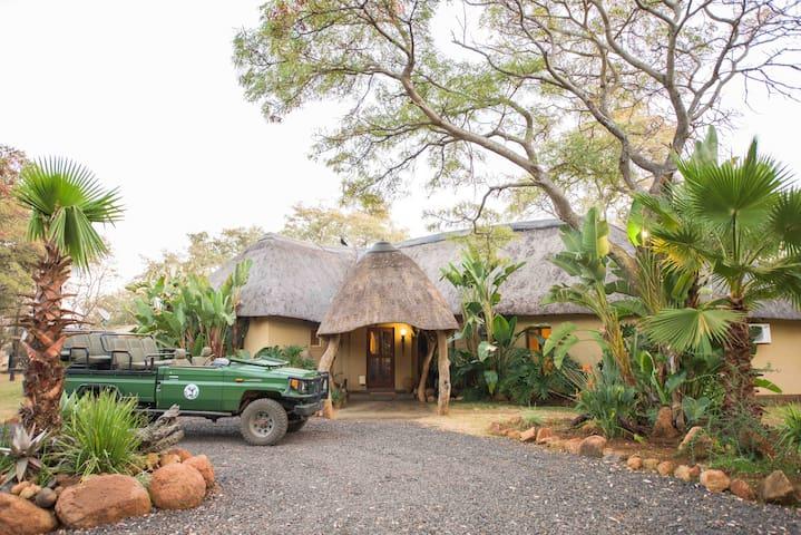 Mziki Safari Lodge - Main Lodge Rooms - twin beds