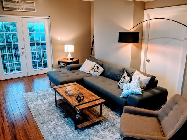 Newly renovated with all new furniture living room.  The door leads to the back deck where you can enjoy incredible views of Pittsburgh.