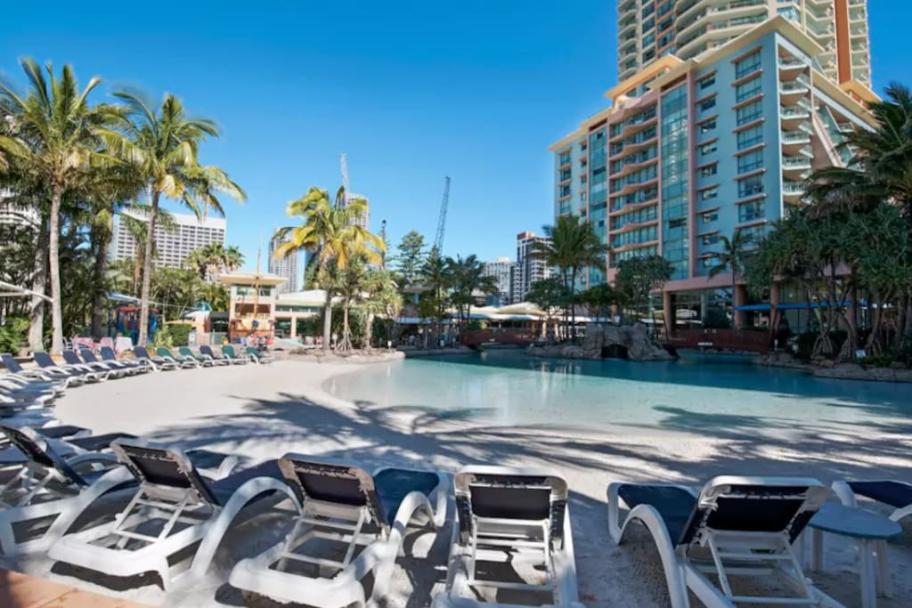 Relax on a deck chair in the amazing poolside grounds.